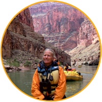 Jean in front of the river, the red cliffs of the Grand Canyon in the background